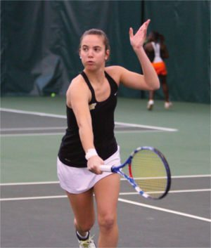 Shocker Tennis player serves the ball.
