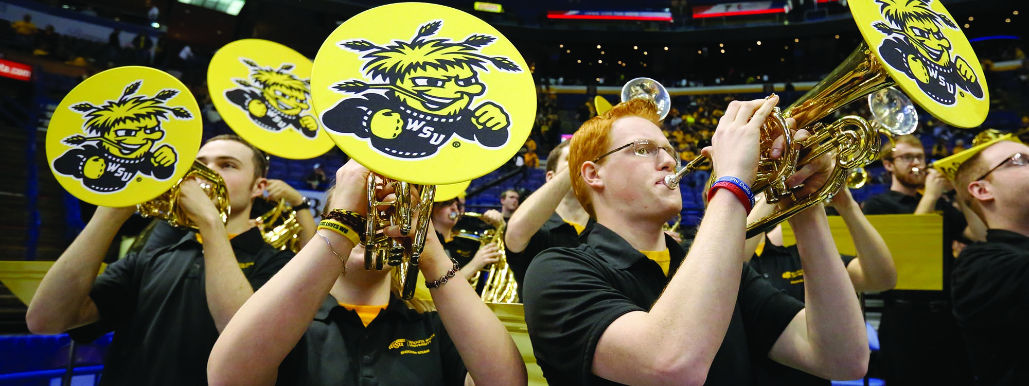 brass players at a basketball game