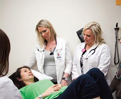 Health professions students with a patient